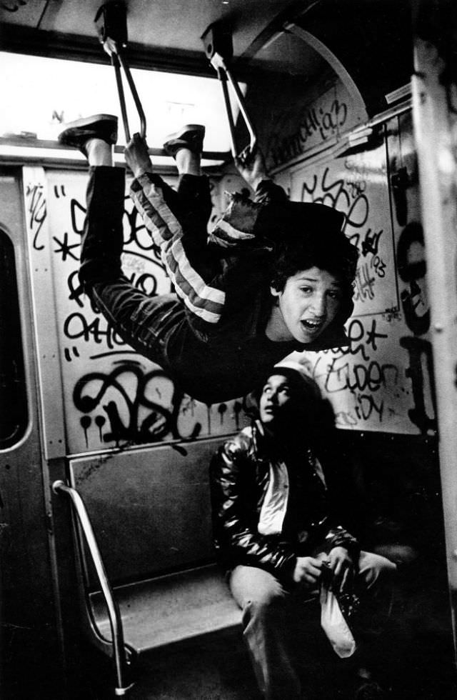 A child prostitute and his friend in the subway, heading home in the Bronx after a night hustling in Times Square.