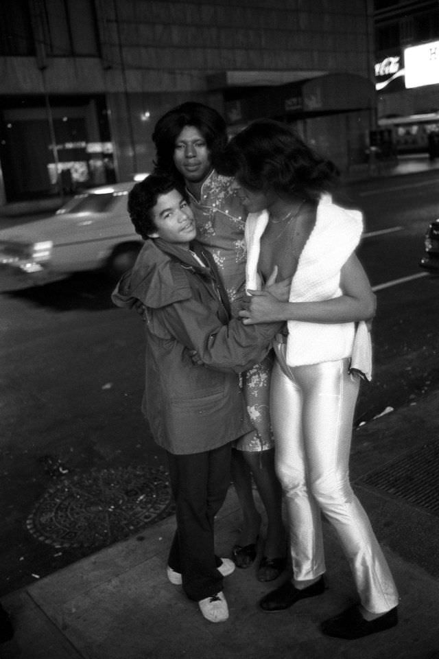 A teenage hustler fooling around with two transvestites.