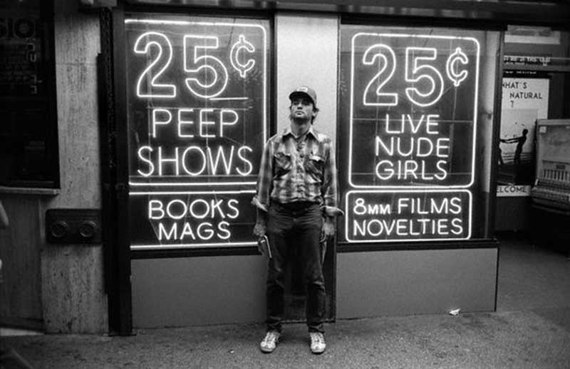 Actor Bill Murray poses in front of the famous 25-cent peep shows of Times Square in the mid-1970s.