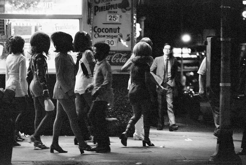 A group of prostitutes walk through the side streets of Broadway and Times Square in New York in the summer of 1971.