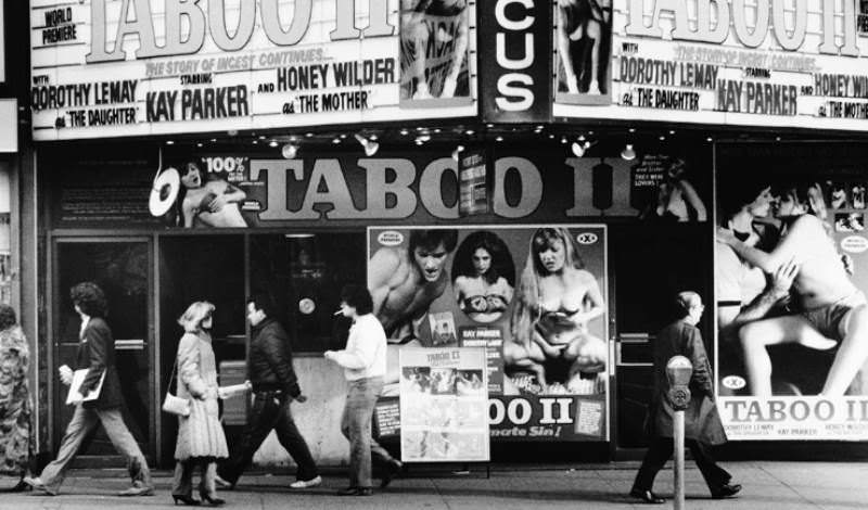 People pass unperturbed by the offerings of Taboo II.
