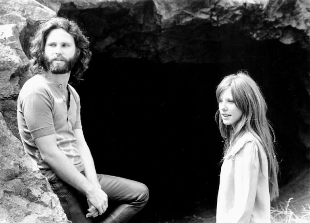 Jim Morrison and Pamela Courson in a cave, 1969