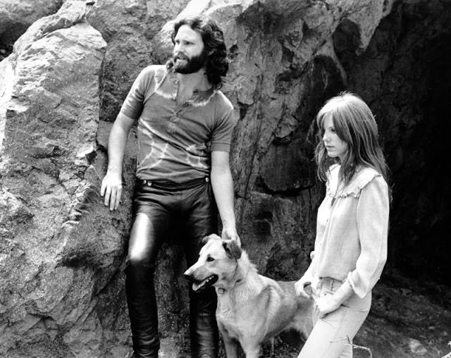 amela Courson and Jim Morrison with a dog, 1969