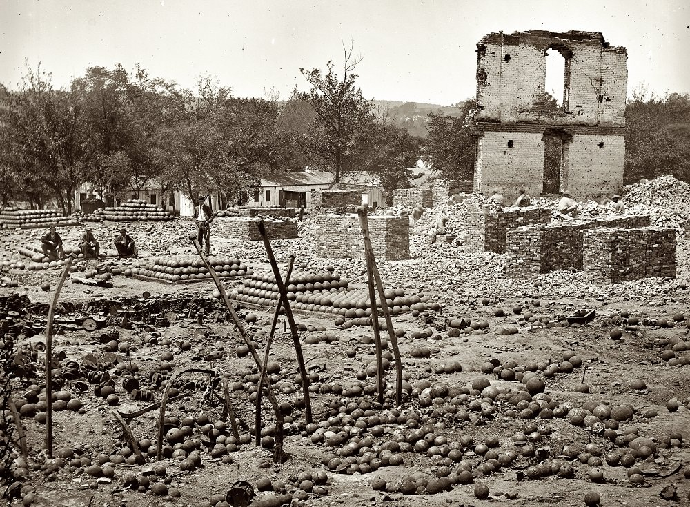 Ruins of the State Arsenal at Richmond showing stacked and scattered ammunition, April 1865
