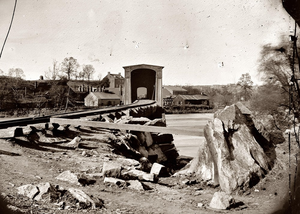 Belle Isle railroad bridge from the south bank of the James River after the fall of Richmond, Spring 1865