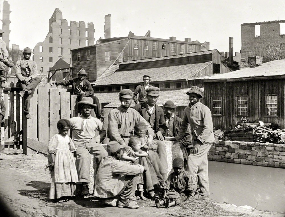 Negro freedmen by canal, a group of Contrabands at Haxall's Mill, Richmond, June 9, 1865