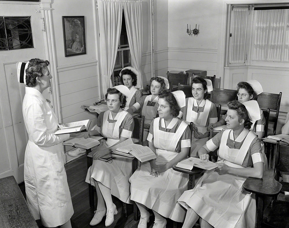 Shirley Babcock at right in the front listening to a lecture with other student nurses, Rochester, N.Y, September 1942