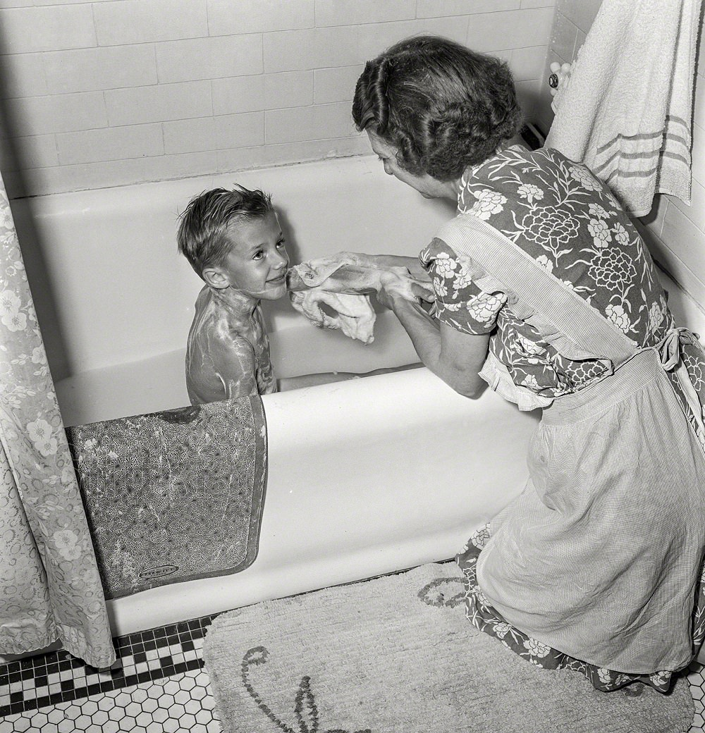 Earl Babcock's mother helping with his bath, Rochester, New York, September 1942