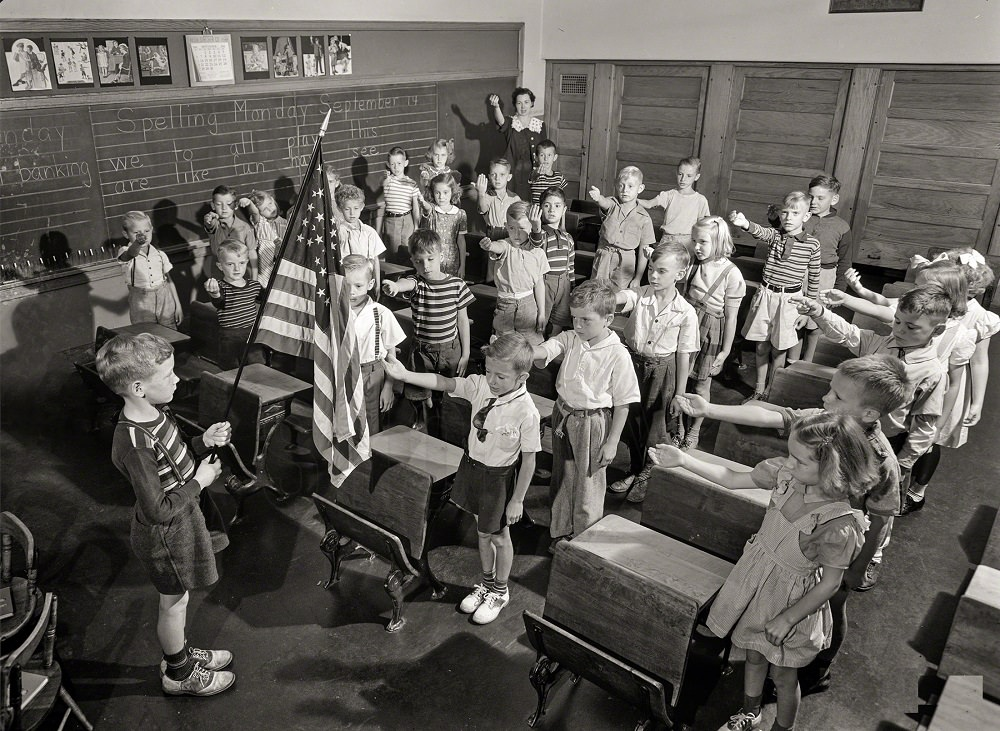Earl Babcock's school day begins with the salute to the flag, Rochester, New York, September 1942
