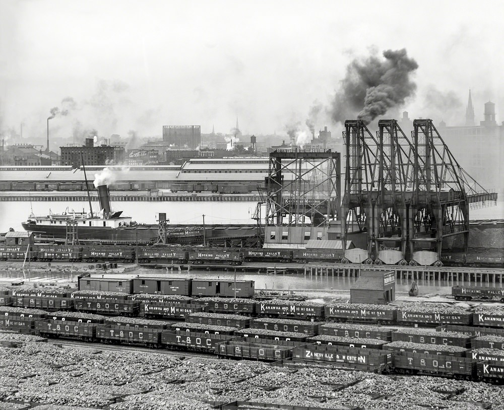 Maumee River waterfront and Railroads represented on the coal cars, 1910
