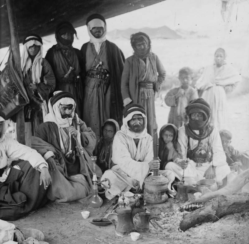 A group of Bedouins prepare coffee in a tent, 1936