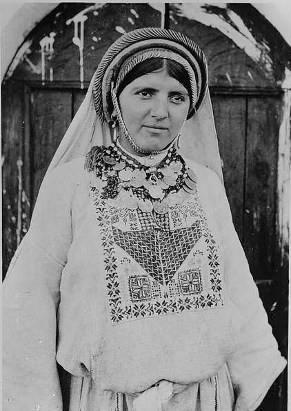 """A woman, labelled, in the original caption, as a """"peasant girl, """"Circa 1900-1920"""