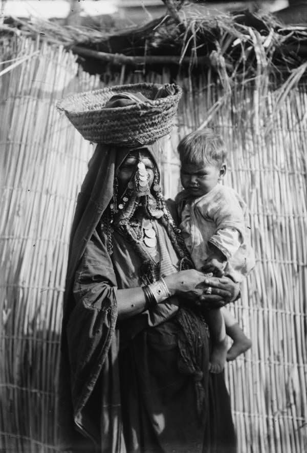 A mother carries her baby.Beersheba, Circa 1900-1920