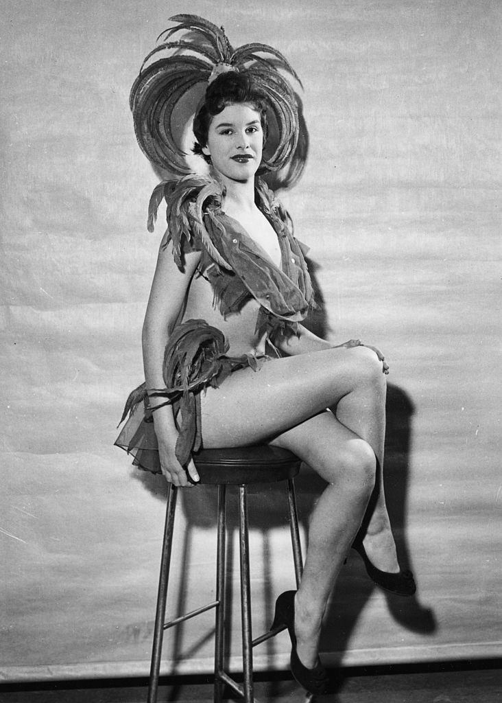 June Wilkinson wearing a feather showgirl costume, circa 1950