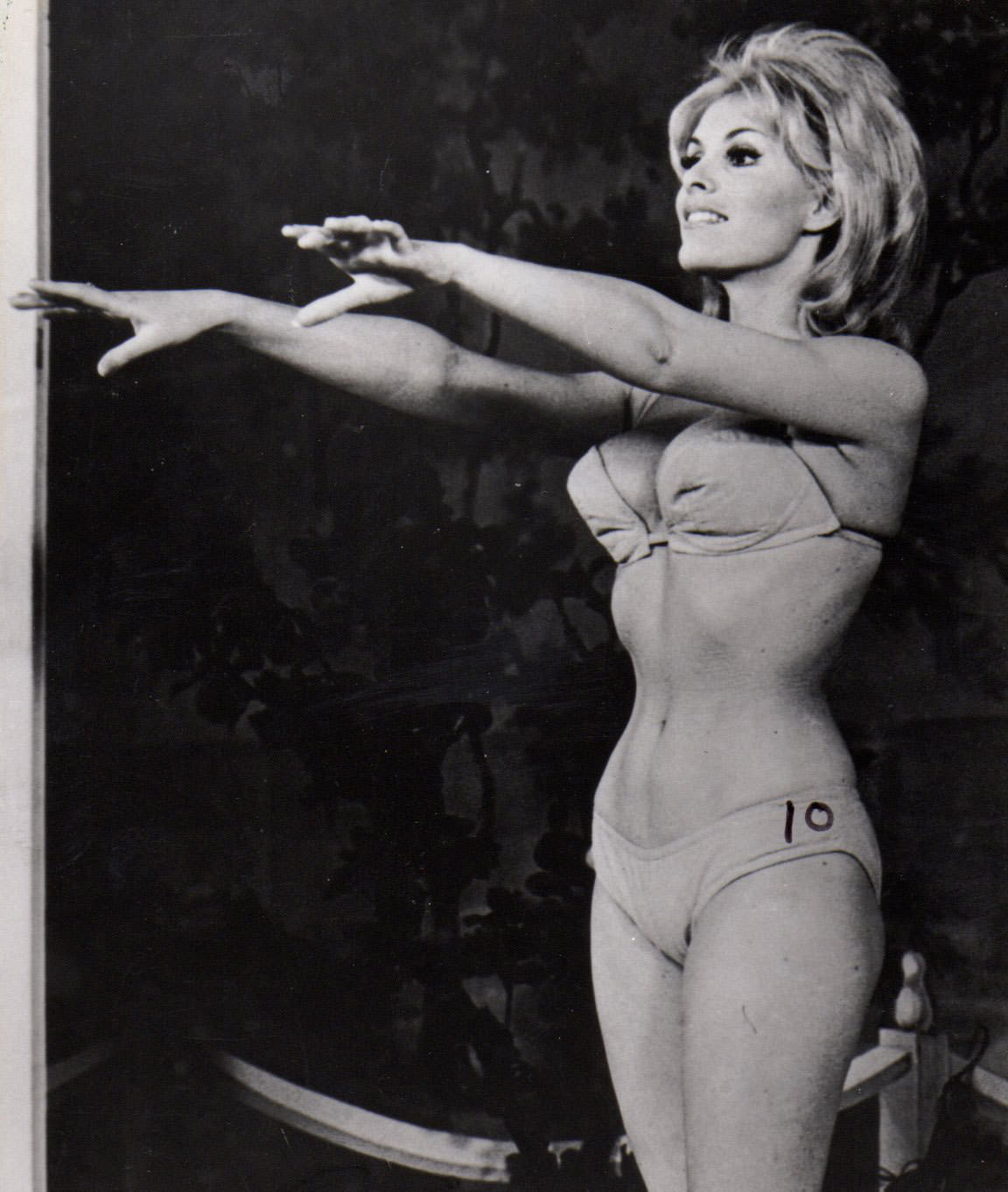 June Wilkinson doing some stretches, 1960s