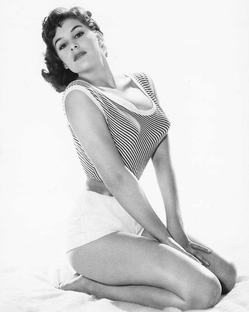 June Wilkinson in  a short -sleeveless striped top with a scoop neckline, 1960