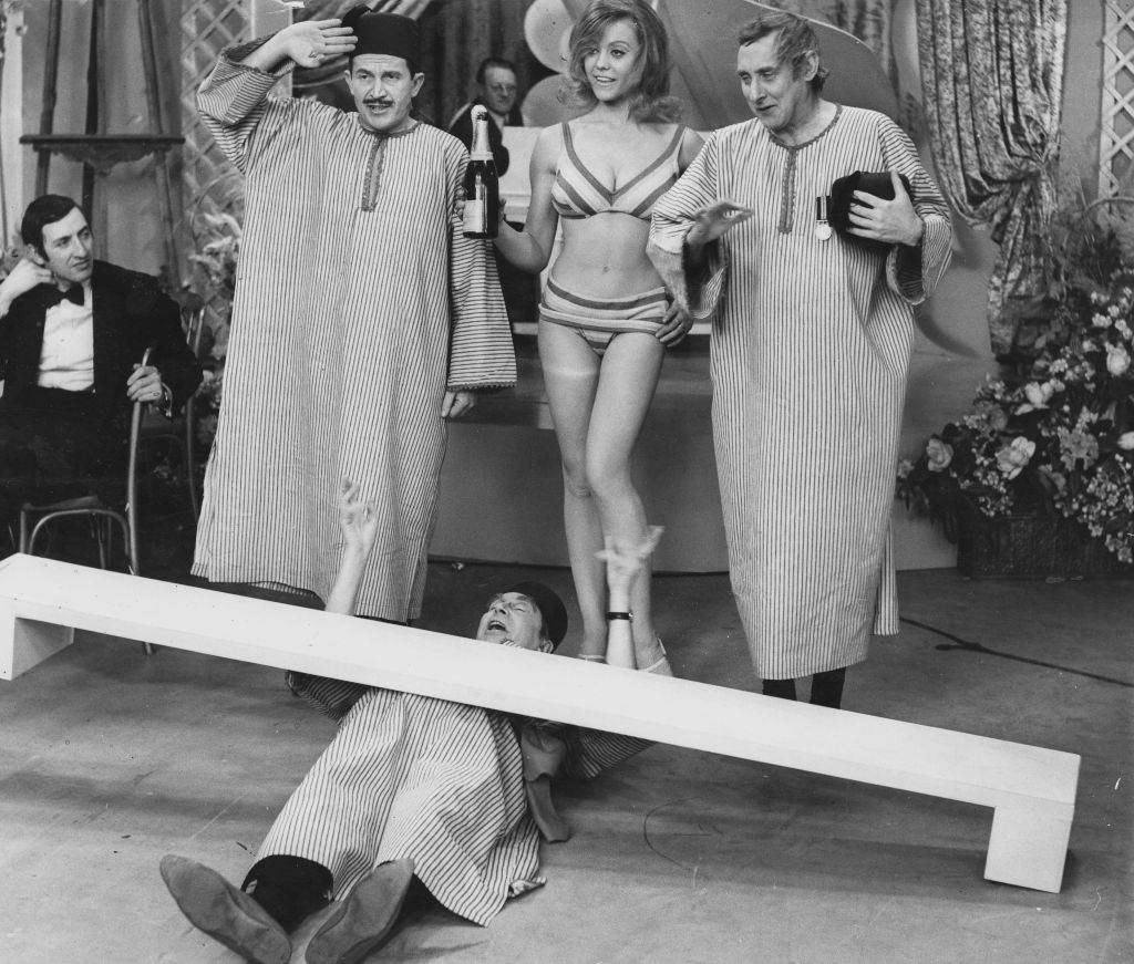 Margaret Nolan with Leon Thau and Clive Dunn in the 'Filthistan Trio' sketch from the television show 'The World of Beachcomber', January 15th 1968.