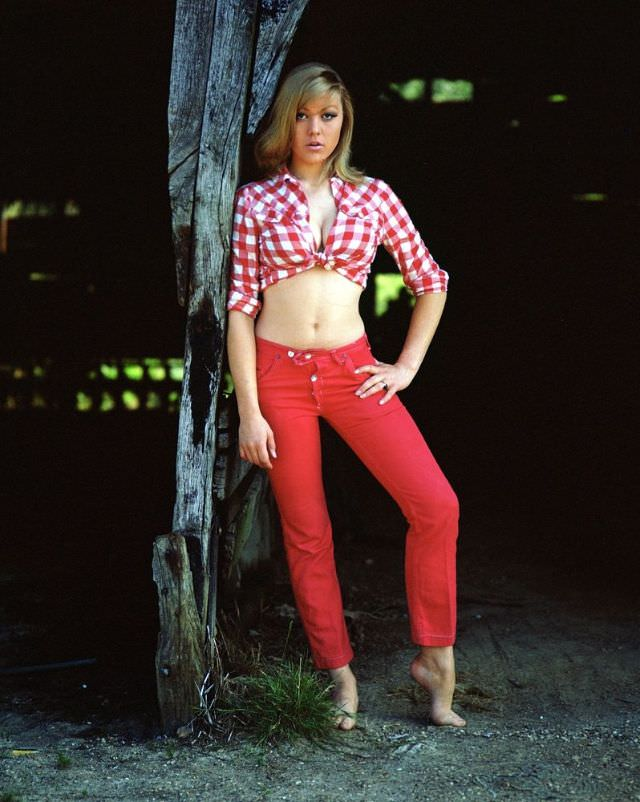 Margaret Nolan in red pant and shirt, 1960s