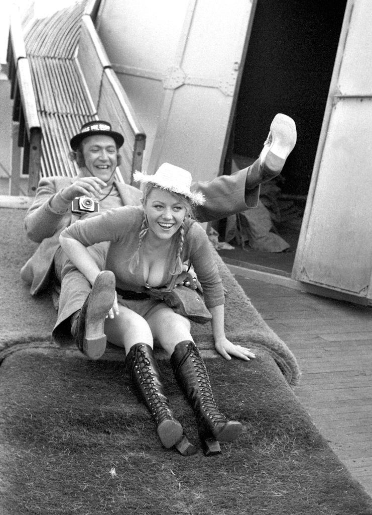 Margaret Nolan with Bernard Bresslaw during the filming of 'Carry On at Your Convenience', Brighton, 1971