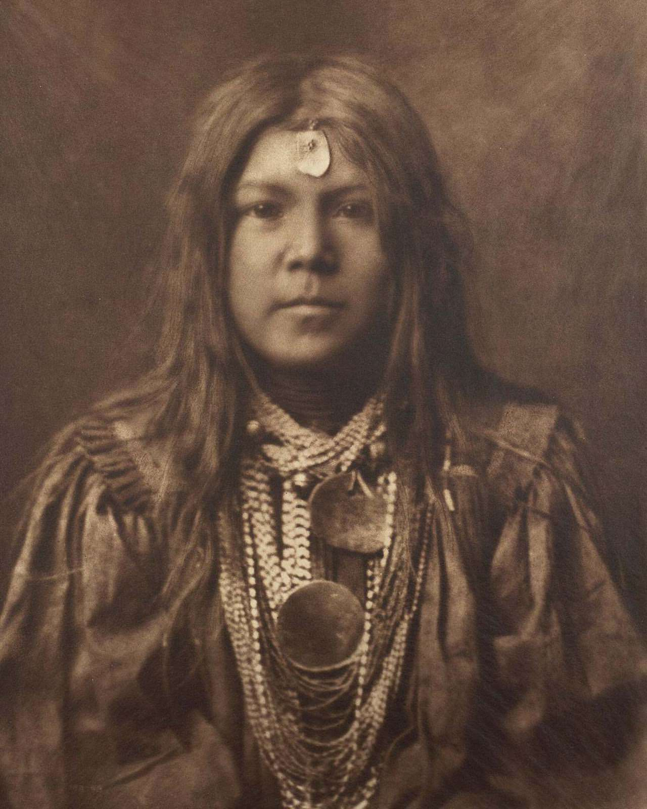 A young member of the Apache tribe. 1910.