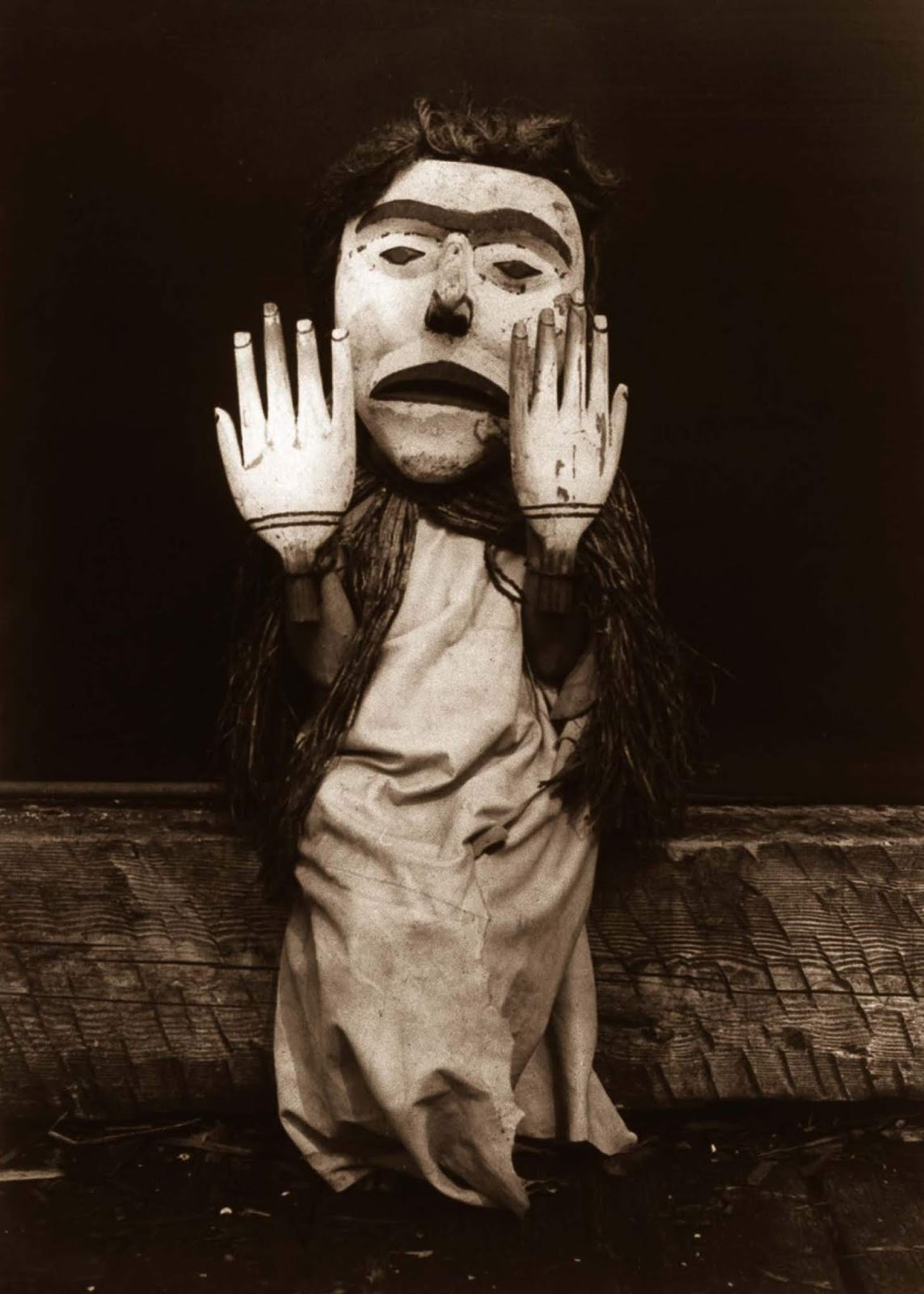 """A Kwakiutl person dressed as a forest spirit, Nuhlimkilaka, (""""bringer of confusion""""). 1914."""
