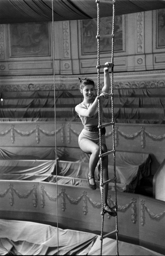 Pier Angeli climbing a rope ladder in the set of 'The Story of Three Loves', United States, circa 1953