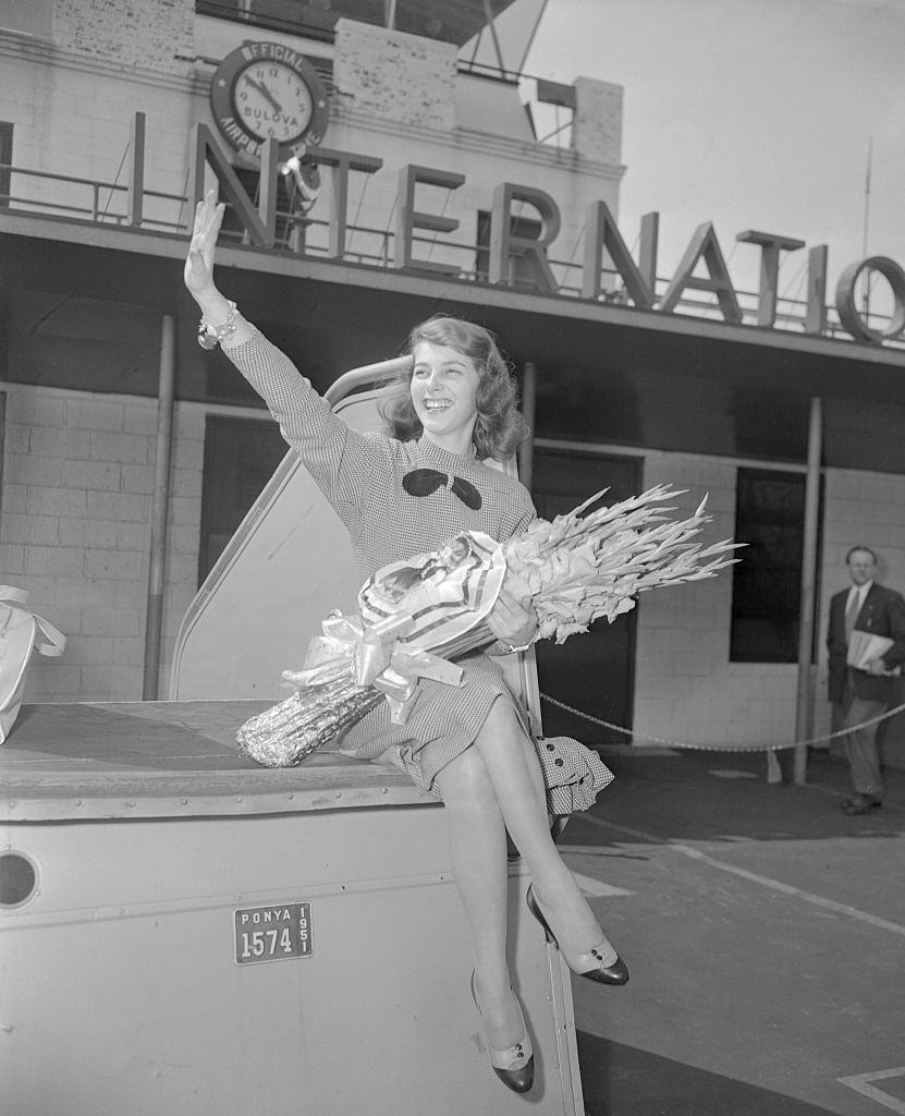 19-year-old Pier Angeli waves at Idlewild Airport on her arrival in New York from Germany.