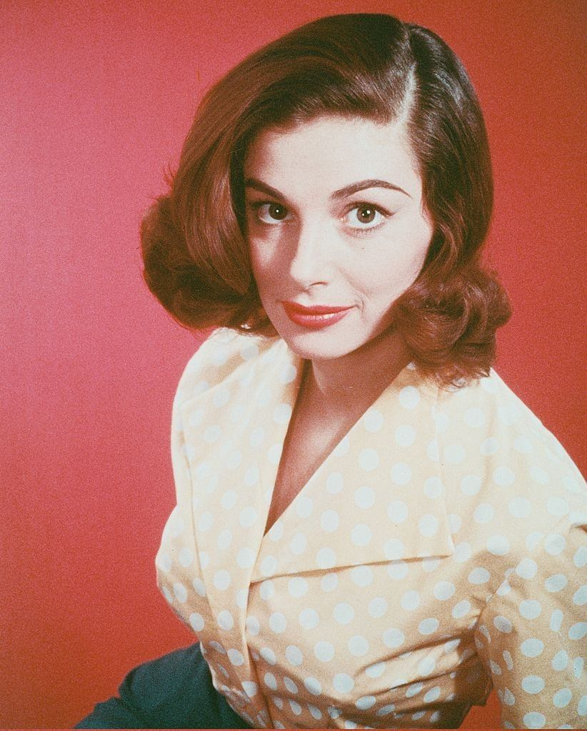 Pier Angeli wearing a peach blouse with white polka dots, 1960