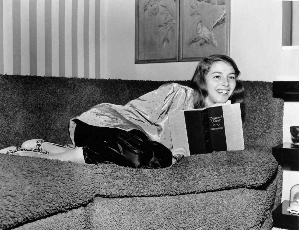 Pier Angeli reading a copy of the book 'National Velvet' by Enid Bagnold, circa 1950