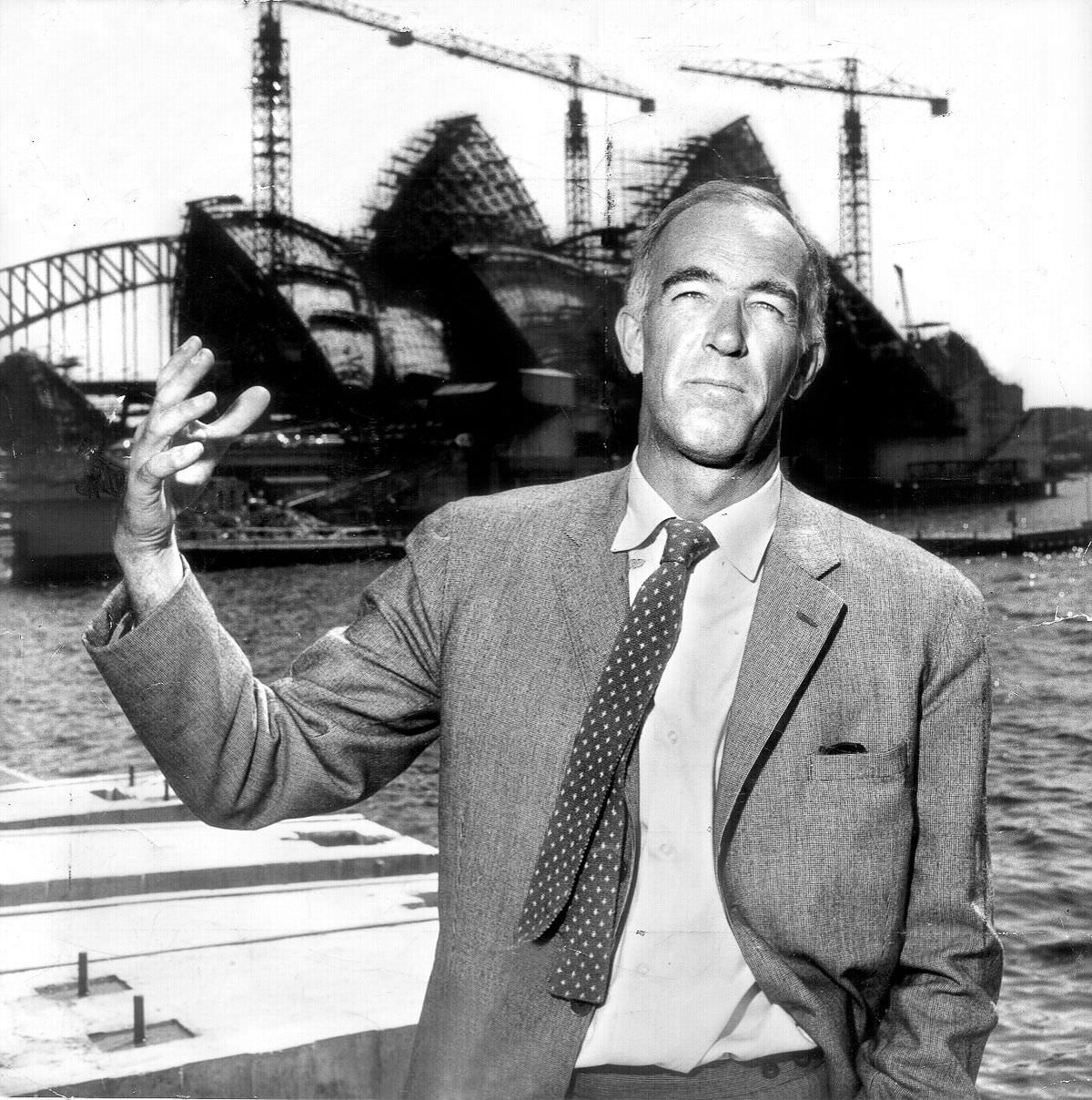 Architect Jørn Utzon in front of the Sydney Opera House, eight years after his designed was selected and six years into construction, 1965