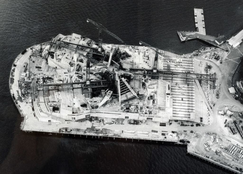 The construction work on the Sydney Opera House as seen from above, An aerial picture looking down on the building work showing the start of the famous shells, 1960