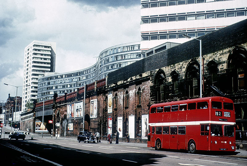 Manchester's famous red buses became grotesque pop orange and brown (London Road, 1975)