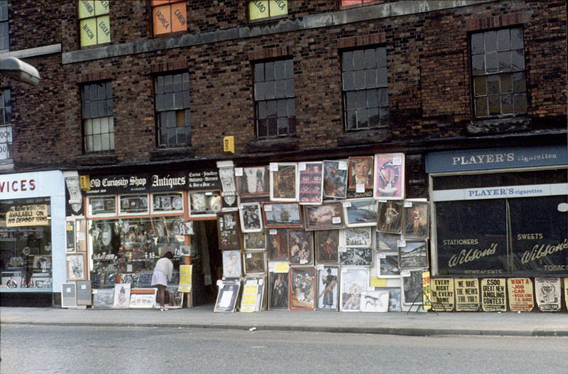 Display of posters and reproduction paintings outside the Old Curiosity Shop on Chapel Street, Salford, September 1973.