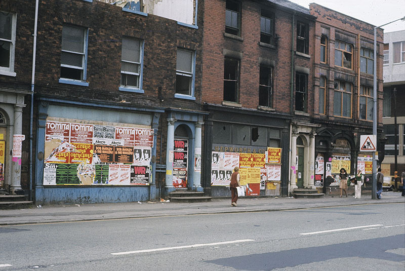 Boarded-up shops (once Georgian houses) on the west side of Oxford Road at All Saints, Manchester, 1976