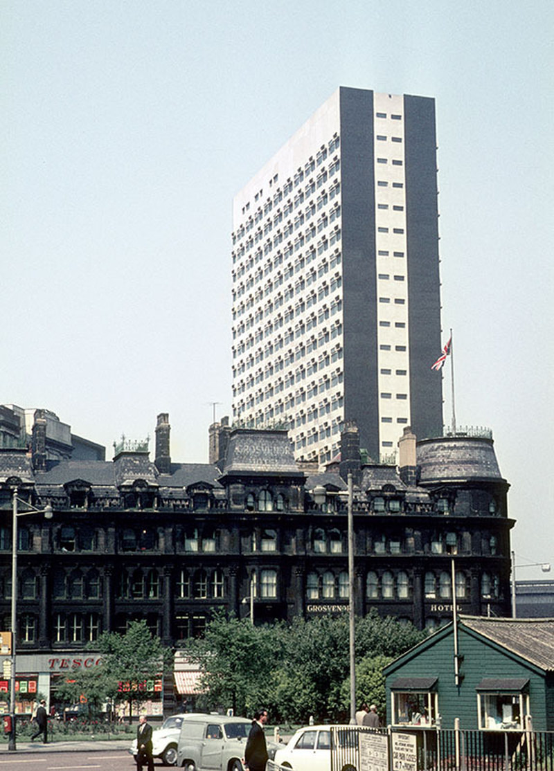 View of Highland House on Victoria Bridge Street, designed by Leach Rhodes Walker and built in 1966. In the foreground is the Grosvenor Hotel at the northern end of Deansgate, demolished c. 1970.
