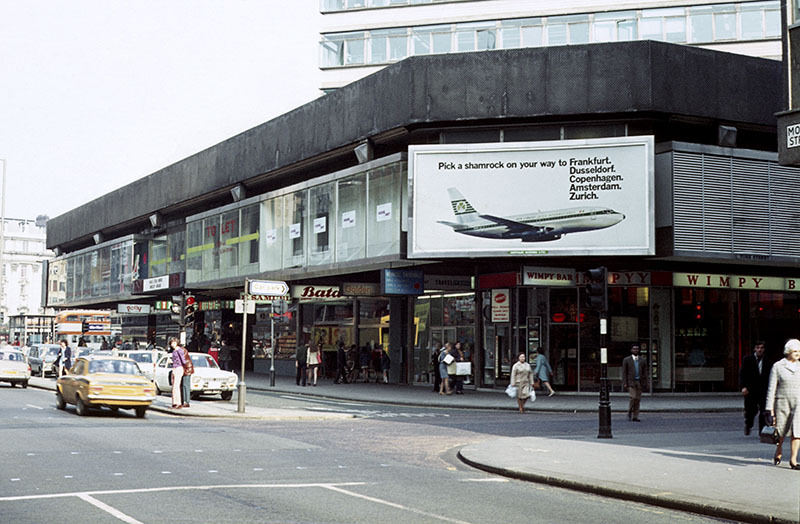 View of Mosley Street at its junction with York Street in 1972, showing shops in the podium element of the Piccadilly Plaza development.