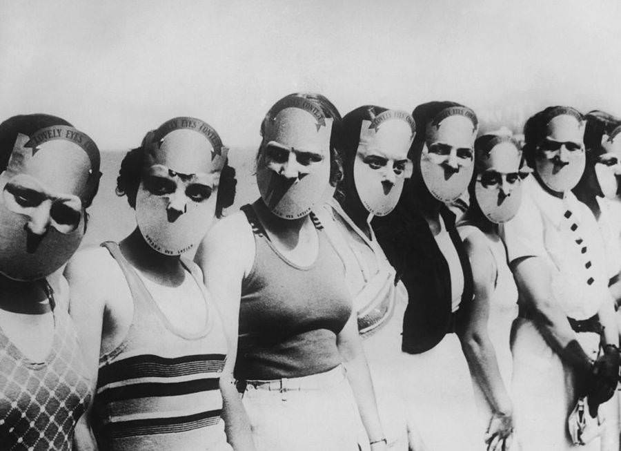Contestants in the Miss Lovely Eyes beauty pageant in Florida wear masks to obscure the rest of their faces, Circa 1930.