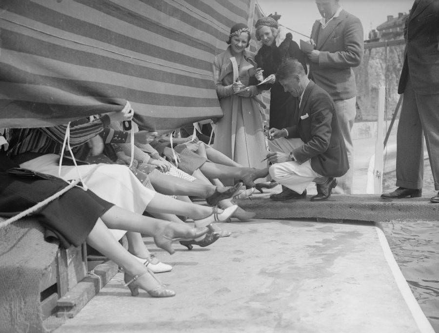 Judges and competitors at a prettiest ankle contest. Cliftonville, Kent, England, 1933.