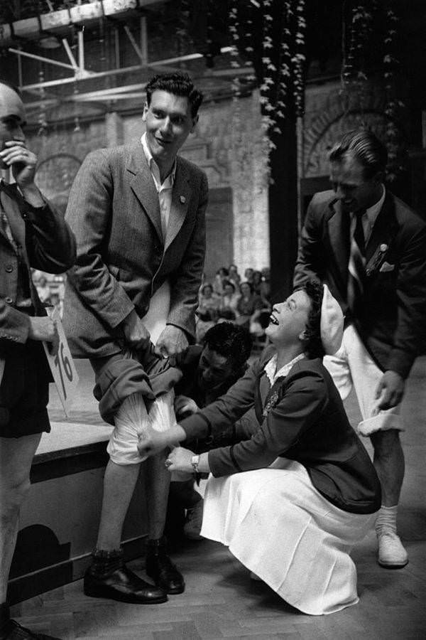 A contestant participates in a knobbly knees competition at Butlin's Holiday Camp in Filey, 1953.