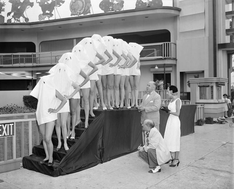 Participants in the Beautiful Leg Contest wear pillow cases over their heads so that the judges can see only their legs. Palisades Amusement Park, New Jersey, 1951.