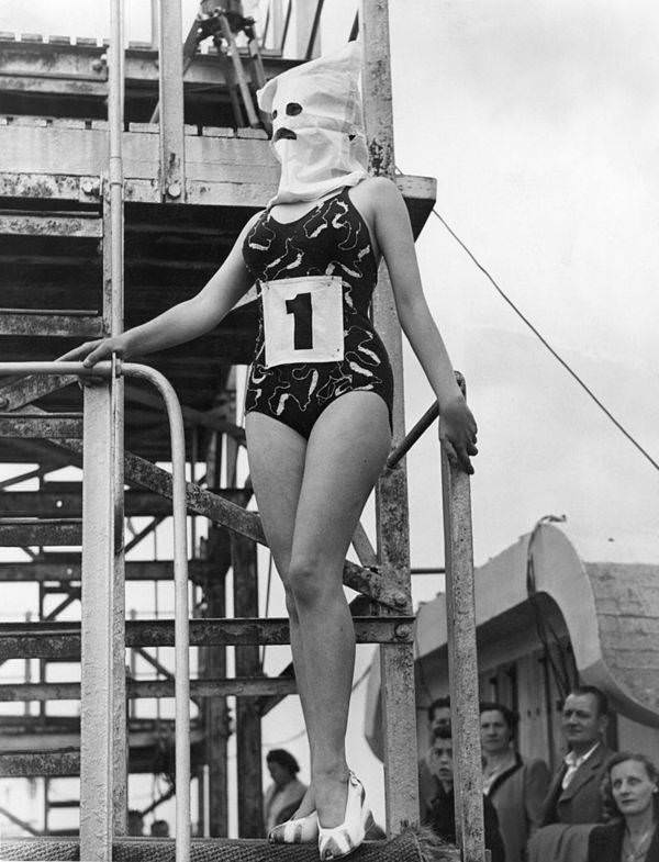 The winner of the Neatest Figure competition at the Lido in Margate, England wears a hood so that the judges could not be influenced by her face and instead only judge her body, 1946