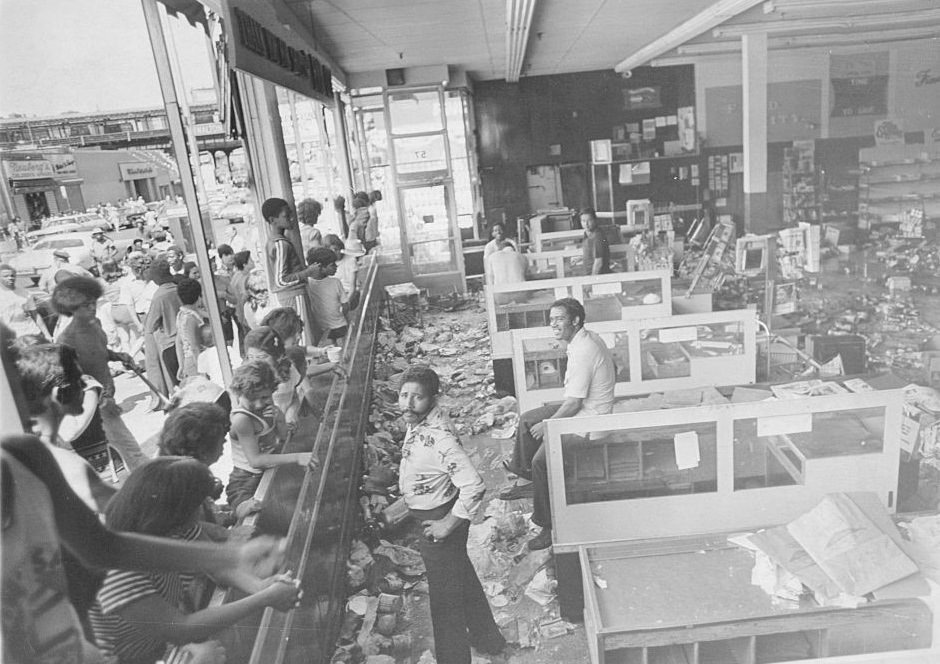 Some stores in the Bronx along the Grand Concourse have been vandalized during the blackout, New York City, July 13, 1977.