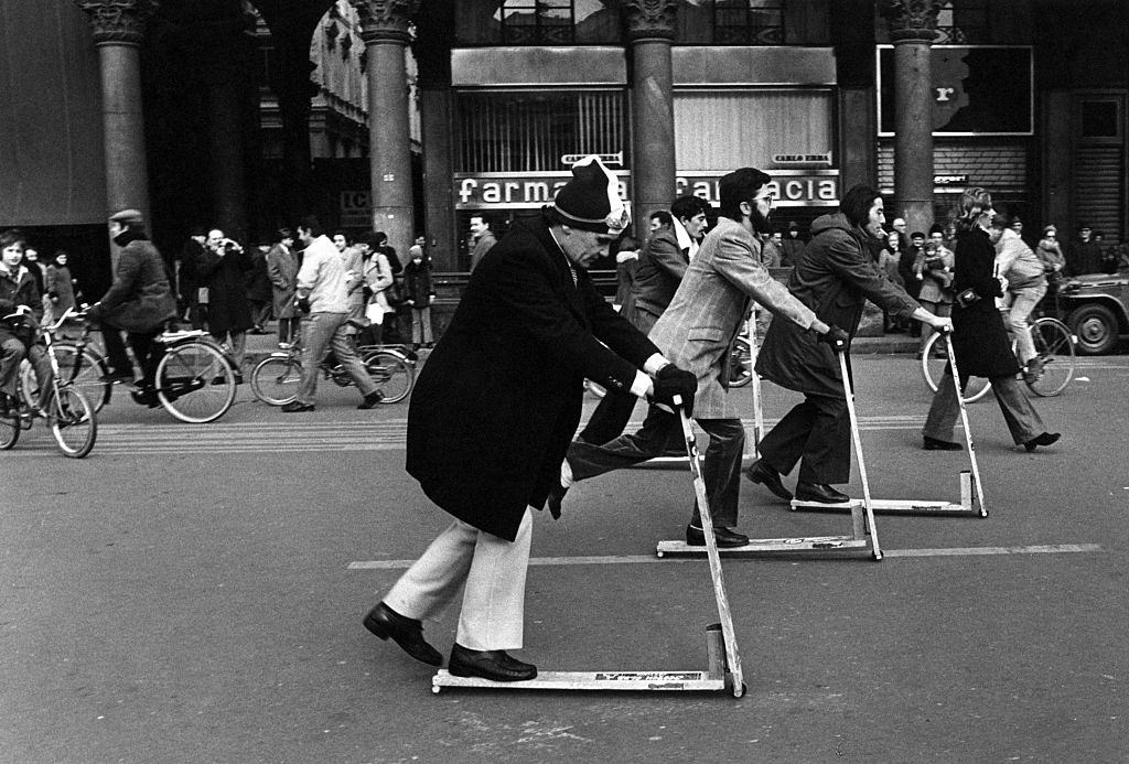 People riding kick scooters on Piazza del Duomo in Milan, December 1973.