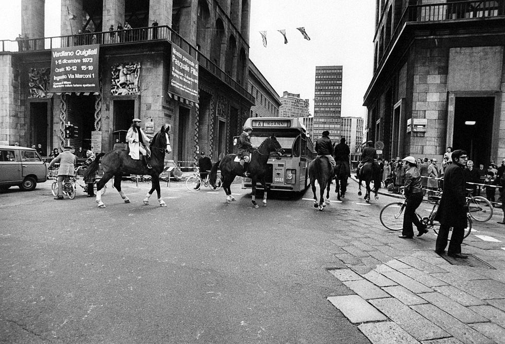 People riding horses on piazza del Duomo in Milan during the oil crisis.