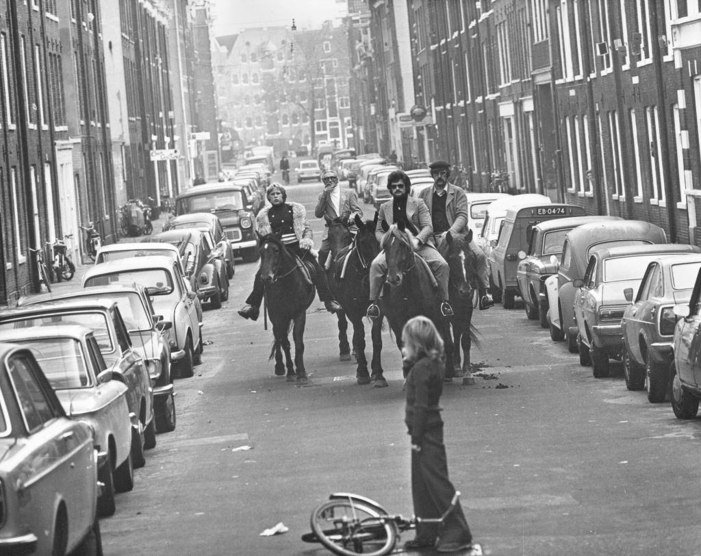 Four horsemen riding through the streets of Amsterdam on a 'motorless day', when cars are prohibited due to the oil crisis, November 1973.