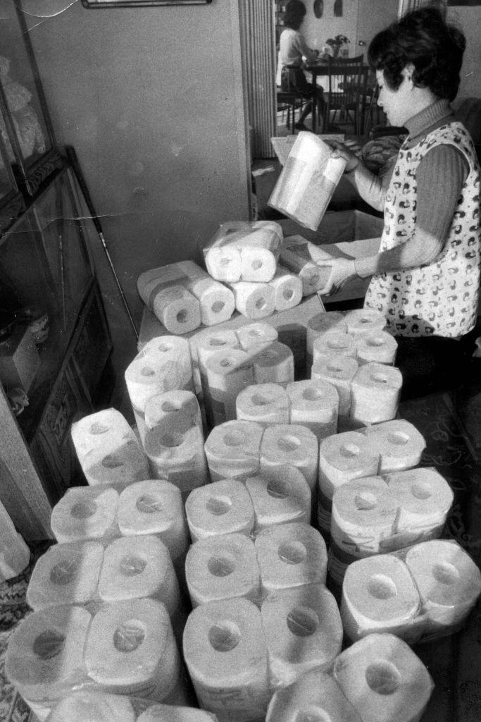 A woman purchases amounts of toilet rolls as oil crisis, Japan.