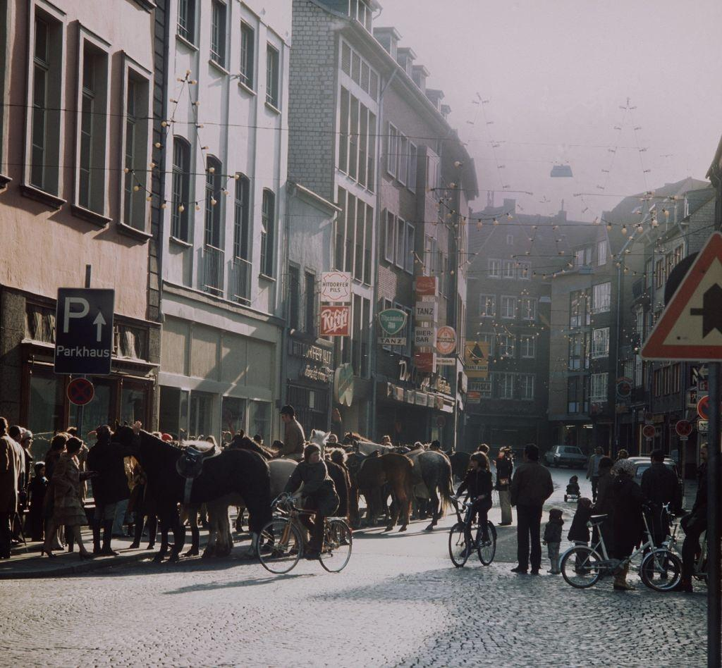 Riders and cyclers gather in the old part of town of Duesseldorf on the 2nd of December in 1973.