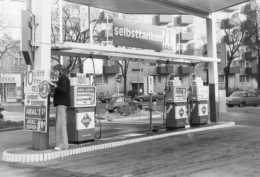 Petrol station with information that only 10 liters are sold per customer due to the oil crisis, Germany - November 1973