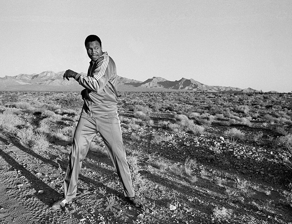 Larry Holmes warming up before an early morning run in the desert outside Las Vegas, circa September 1980.