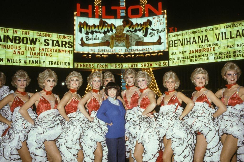 Mireille Mathieu with Jacki Clerico and his wife and the Moulin Rouge troupe in Las Vegas, 1982.